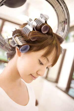 perm: Japanese girl in the beauty parlor for a perm Stock Photo