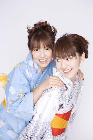 unlined: Japanese girls wearing yukata Stock Photo