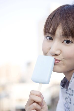 unlined: Japanese girl eating a ice lolly