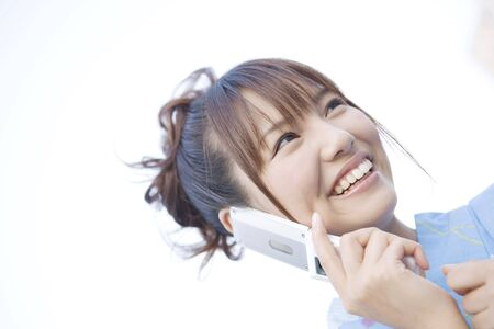 unlined: Japanese girl talking with a cell phone