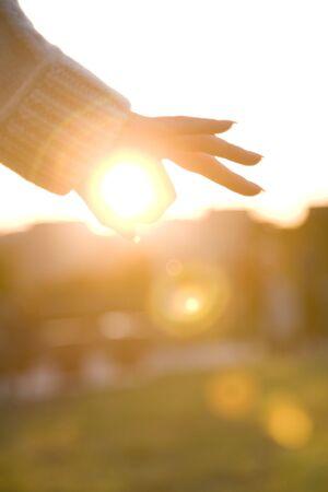 encircling: Finger encircling sun
