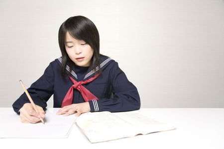 junior high: Japanese junior high school girl studying Stock Photo