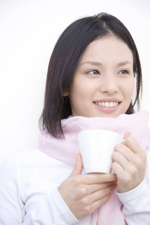 gripping: Woman gripping a coffee cup