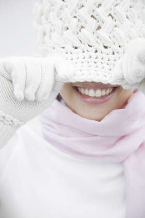 japanes: Woman covering the face with a knit hat Stock Photo