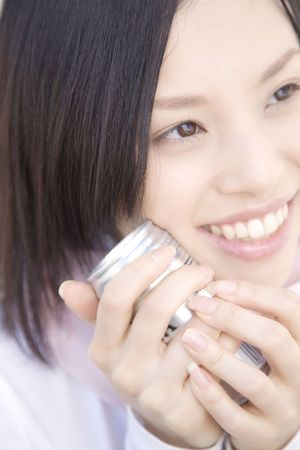 japanes: Woman gripping a can coffee Stock Photo