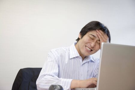 worrying: Japanese office worker worrying