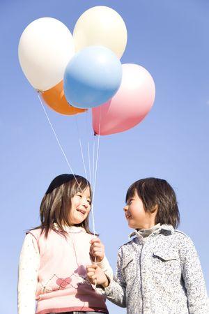 japanese children: Japanese children having balloons Stock Photo