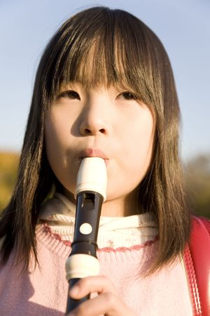 recorder: Japanese girl playing the recorder