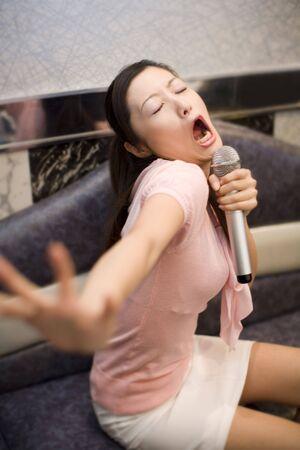enthusiastically: Woman who does karaoke