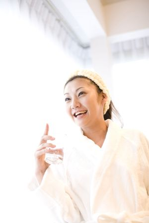 woman in bath: Japanese woman after taking a bath