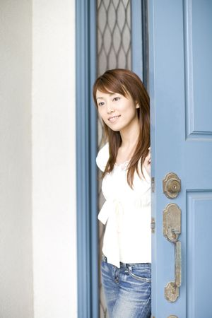 staying: Japanese woman staying still near a door Stock Photo