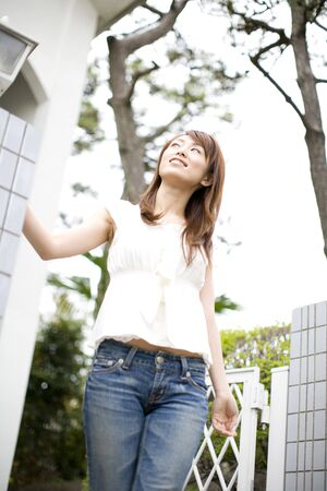 going out: Japanese woman going out from home Stock Photo
