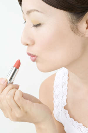 making up: Japanese woman making up