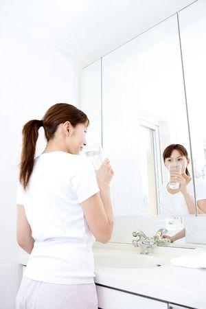 washstand: Japanese woman gargling Stock Photo