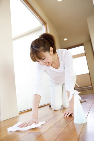 Japanese woman cleaning up the floor Stock Photo