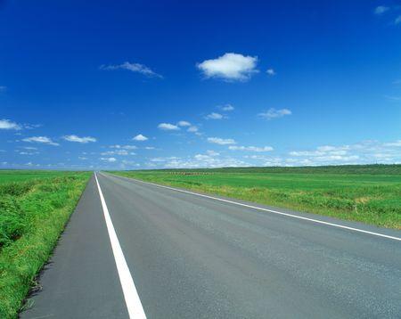 地平線につながる道路 写真素材