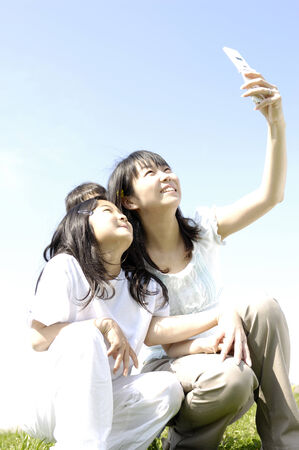 Parent and child who sees a portable Stock Photo - 6193603