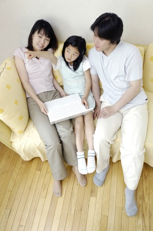 Family which relaxes at the living room Stock Photo - 6193655