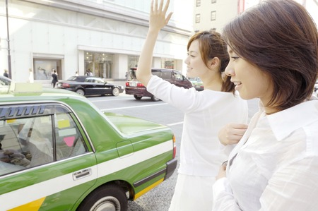 Women who stops a taxi Stock Photo - 6193723