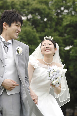 新郎新婦の笑みを浮かべてください。 写真素材