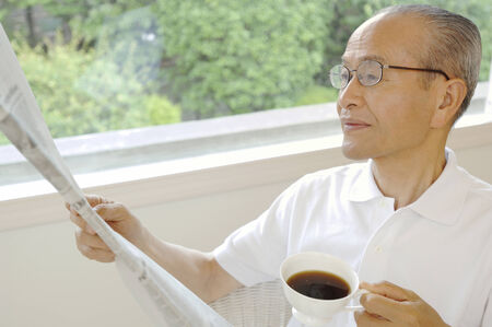 Senior who reads a newspaper photo