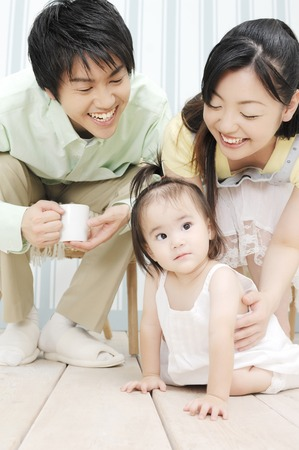 japanese family: Parents who love a baby Stock Photo