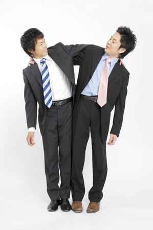 各肩に取り組むビジネスマン 写真素材