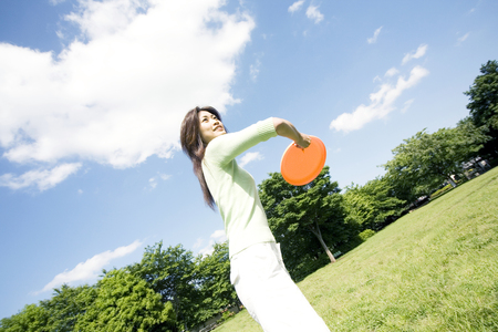 flying disc: Woman playing flying disc Stock Photo