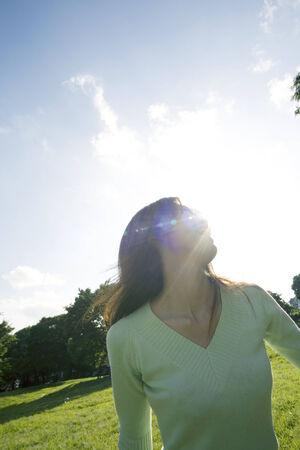 Woman below the blue sky Stock Photo - 6194412
