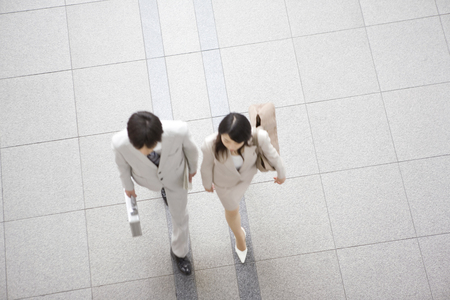 Office workers walking along together photo