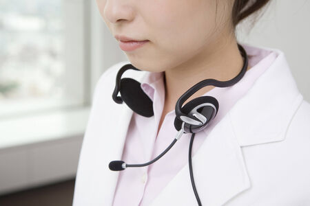 Woman putting on a headset Stock Photo - 6194496