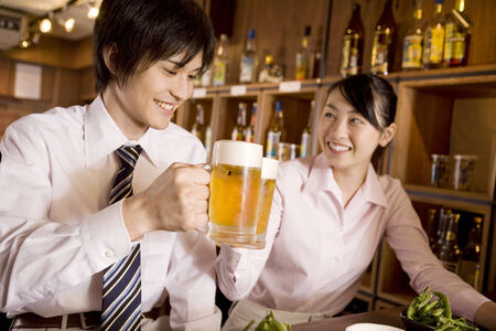 Office workers enjoy drinking a beer Stock Photo