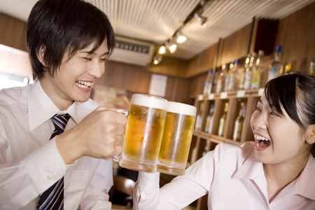 Office workers enjoy drinking a beer 写真素材
