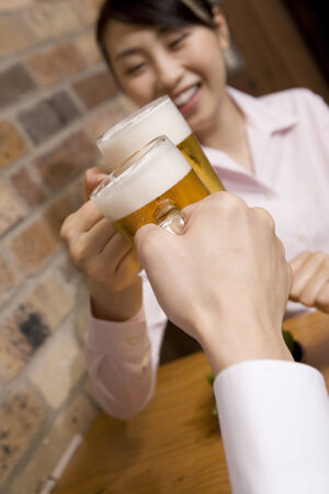 Hand having a beer mug