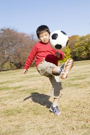boys soccer: Japanese boy playing soccer