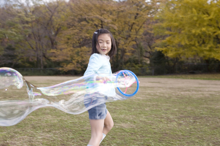Japanese girl playing with bubble photo