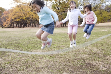 skip: Japanese children skip a rope in the park
