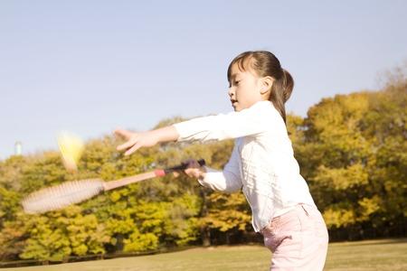 Japanese girl playing badminton photo