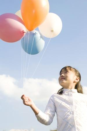 Japanese girl having balloons Stock Photo