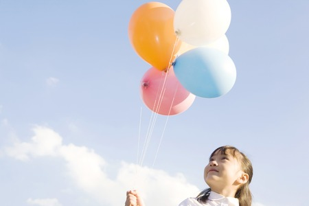 Japanese girl having balloons photo