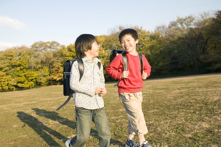 comrade: Japanese boys walking through the park Stock Photo