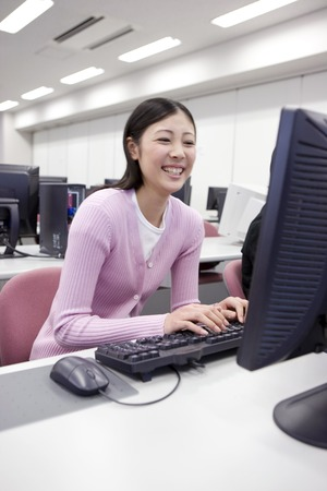 computer lessons: Japanese female student operating a PC