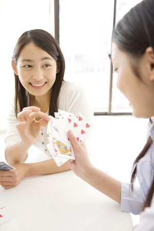 card game: Japanese young woman playing a cards