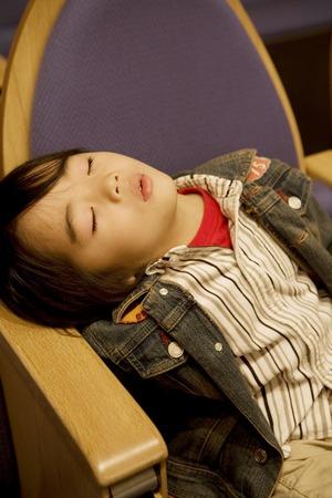 Japanese child sleeping on a seat