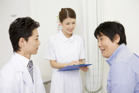 quack: Doctors and nurses in the examination of the male patient Stock Photo