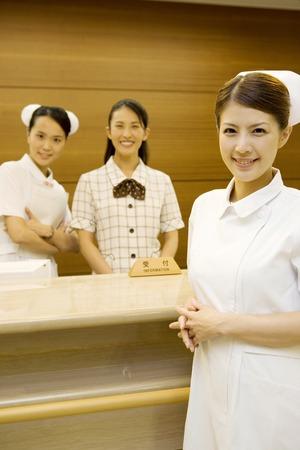 asian hospital: Hospital reception women and nurses