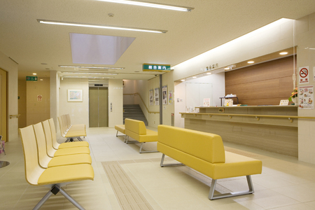 assignation: Hospital receptionist and waiting sofa Stock Photo