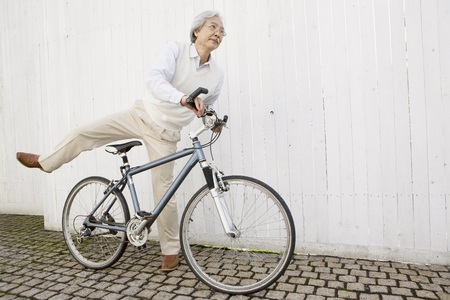 stride: Senior across the bicycle man