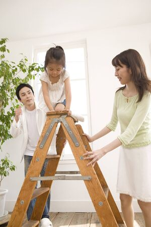 stepladder: Parents watch the girl to climb to stepladder