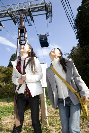 ropeway: 2 women looking up the ropeway